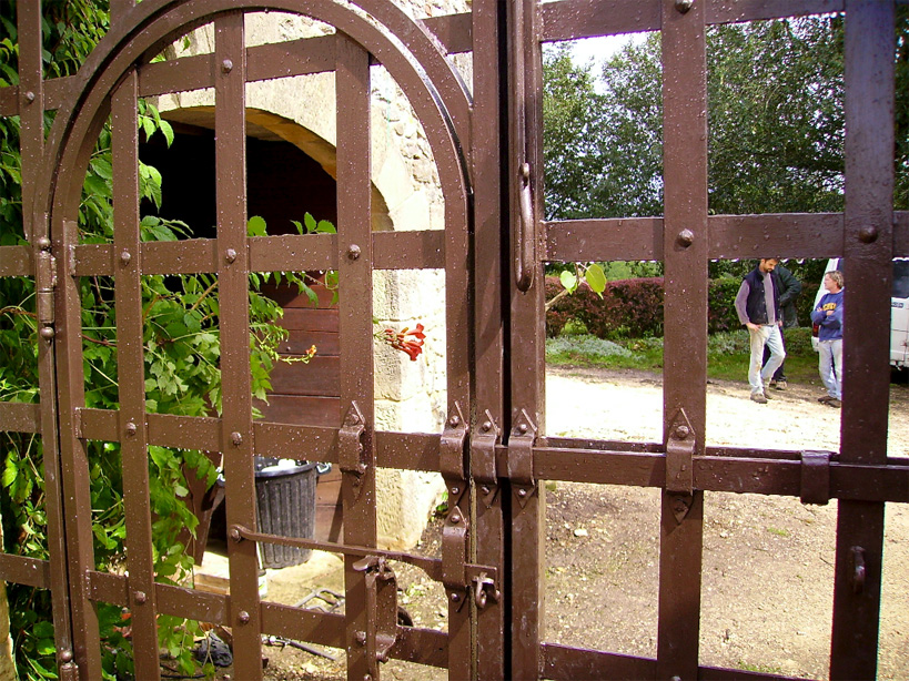 The small door in the gates with it's closing mechanism