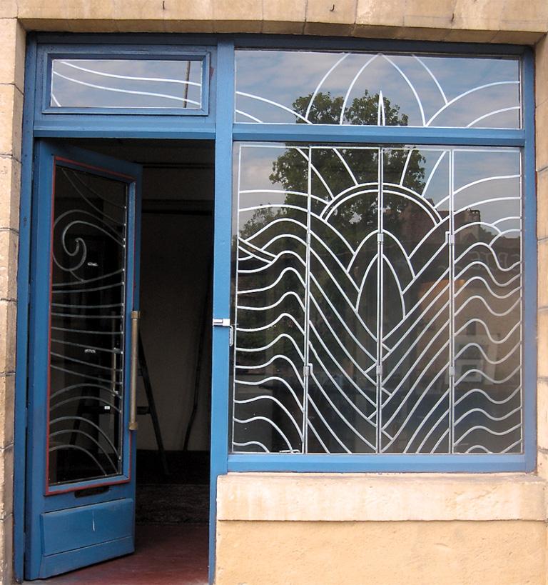 Art nouveau for this shop window the grill work slides open on rails