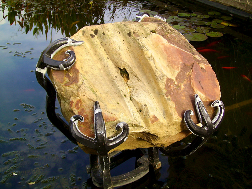 My client asked me to set this stone in his carp pool so i did just that using a claw setting from my jewellery making years
