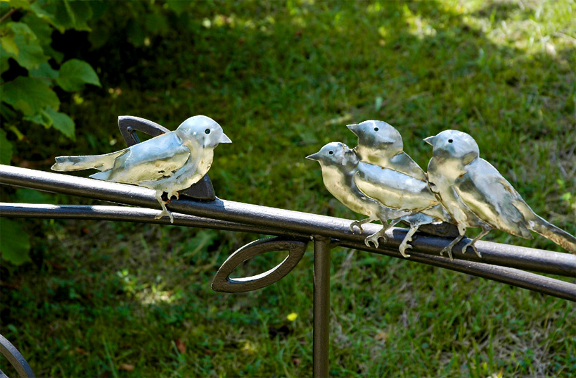 Small group of finches, stainless steel