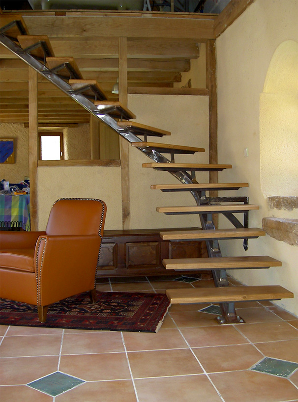 These quarter turned free standing stairs are made on a single central iron beam